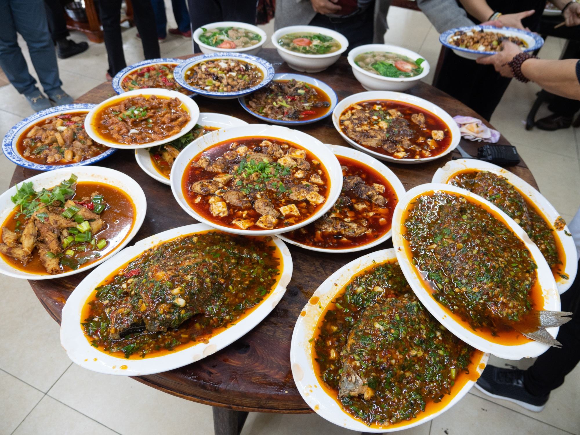 a huge table full of sichuan food in chengdu china