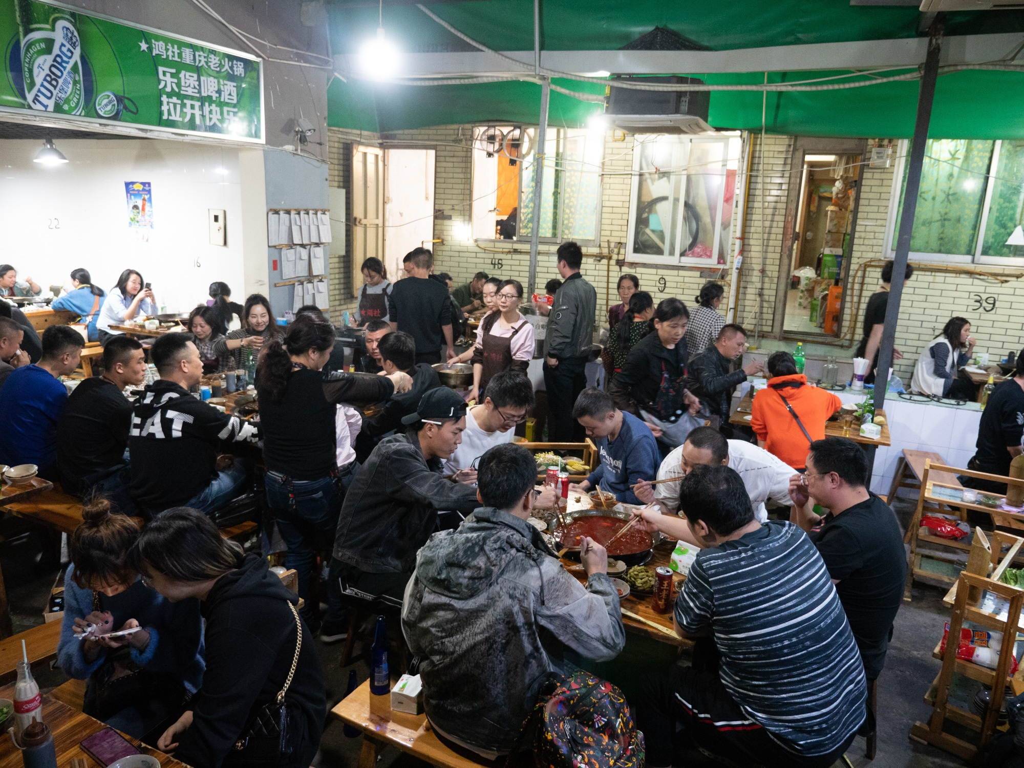 One of the busiest and spiciest hot pot joints in Chengdu