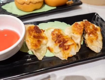 beef potsticker dumplings with vinegar in a dim sum restaurant in hong kong