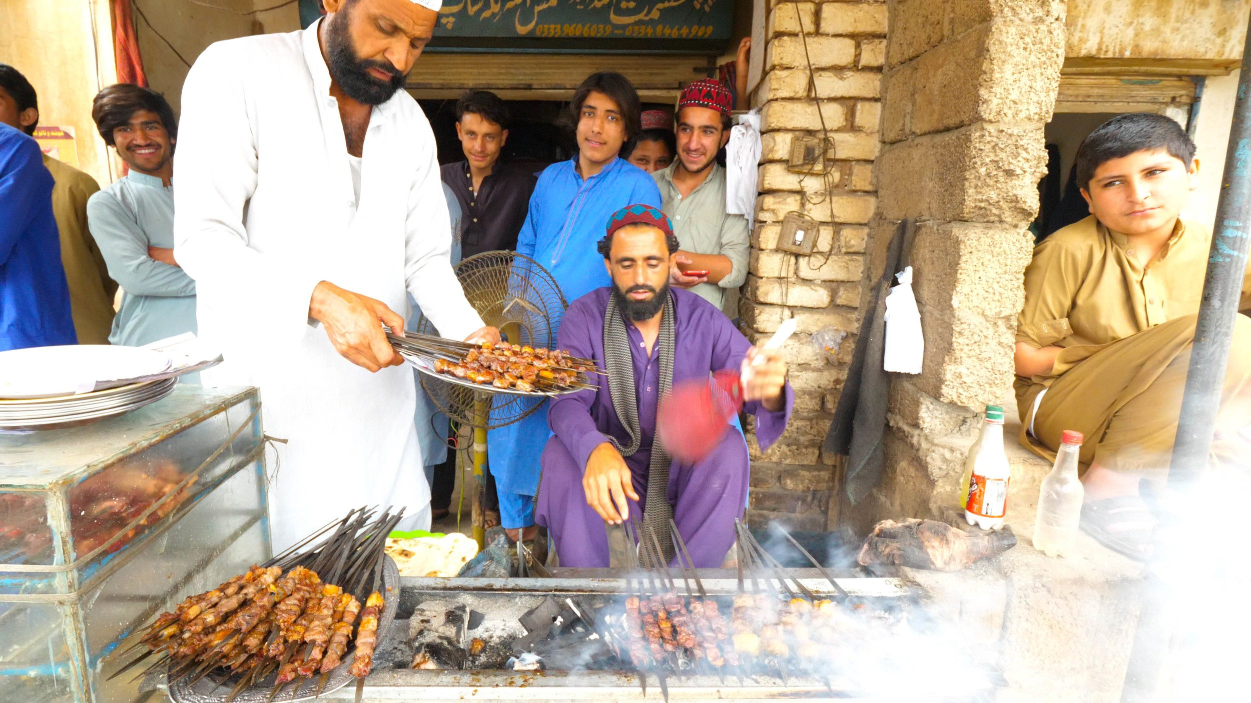 Street food vendor on our drive up to miranshah selling beef kababs