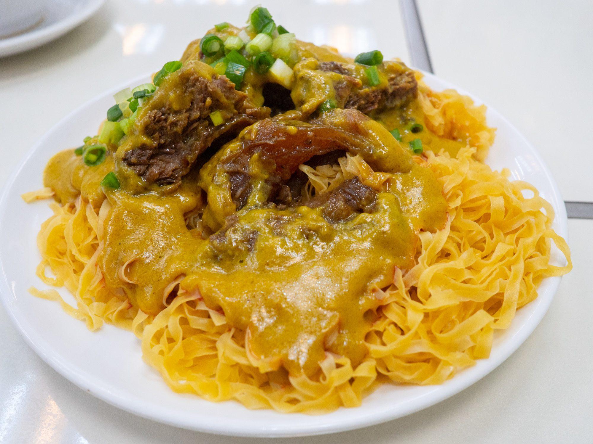Beef curry brisket egg noodles at kun kei in kowloon, hong kong