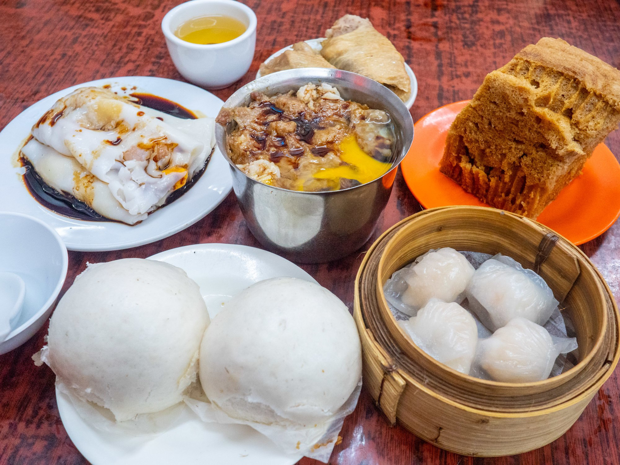Pork buns, shrimp dumplings, and the cheong fun rice noodle rolls are all pictured here