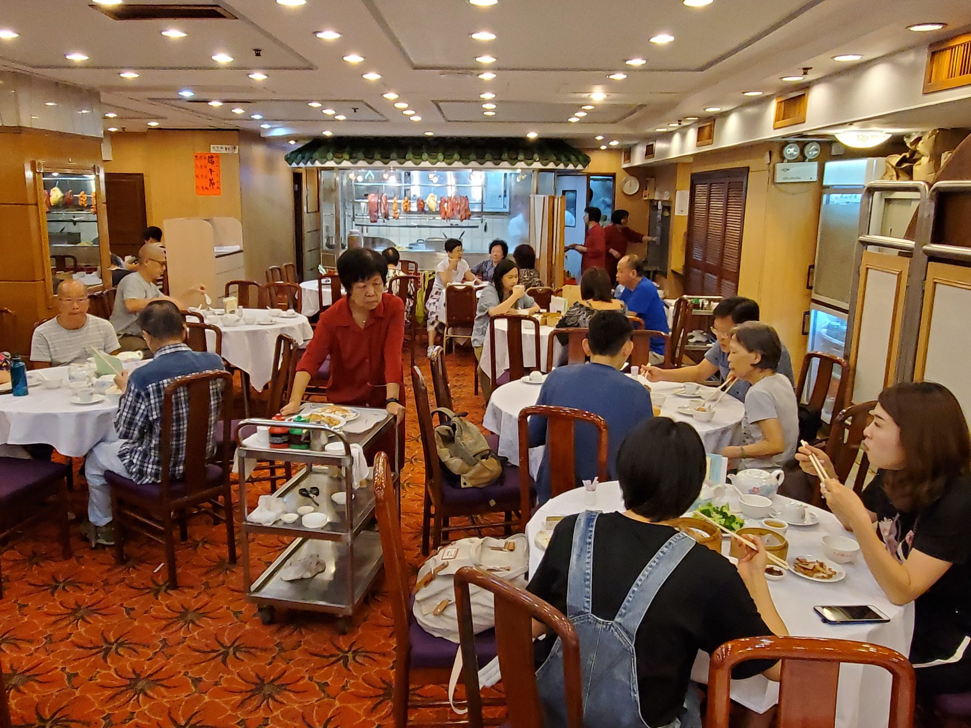 Busy diners eat dim sum specialties in hong kong