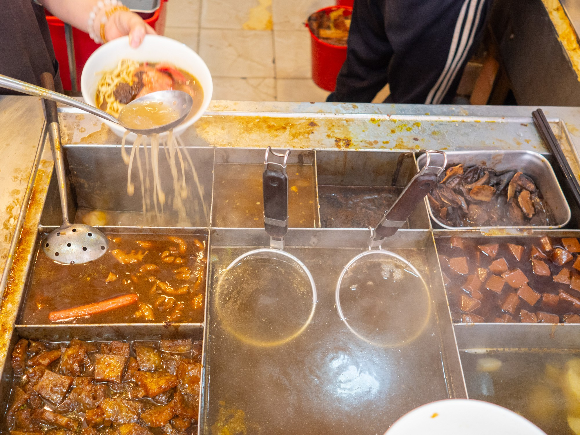 A huge selection of toppings to choose from when you order the cart noodles in Hong Kong
