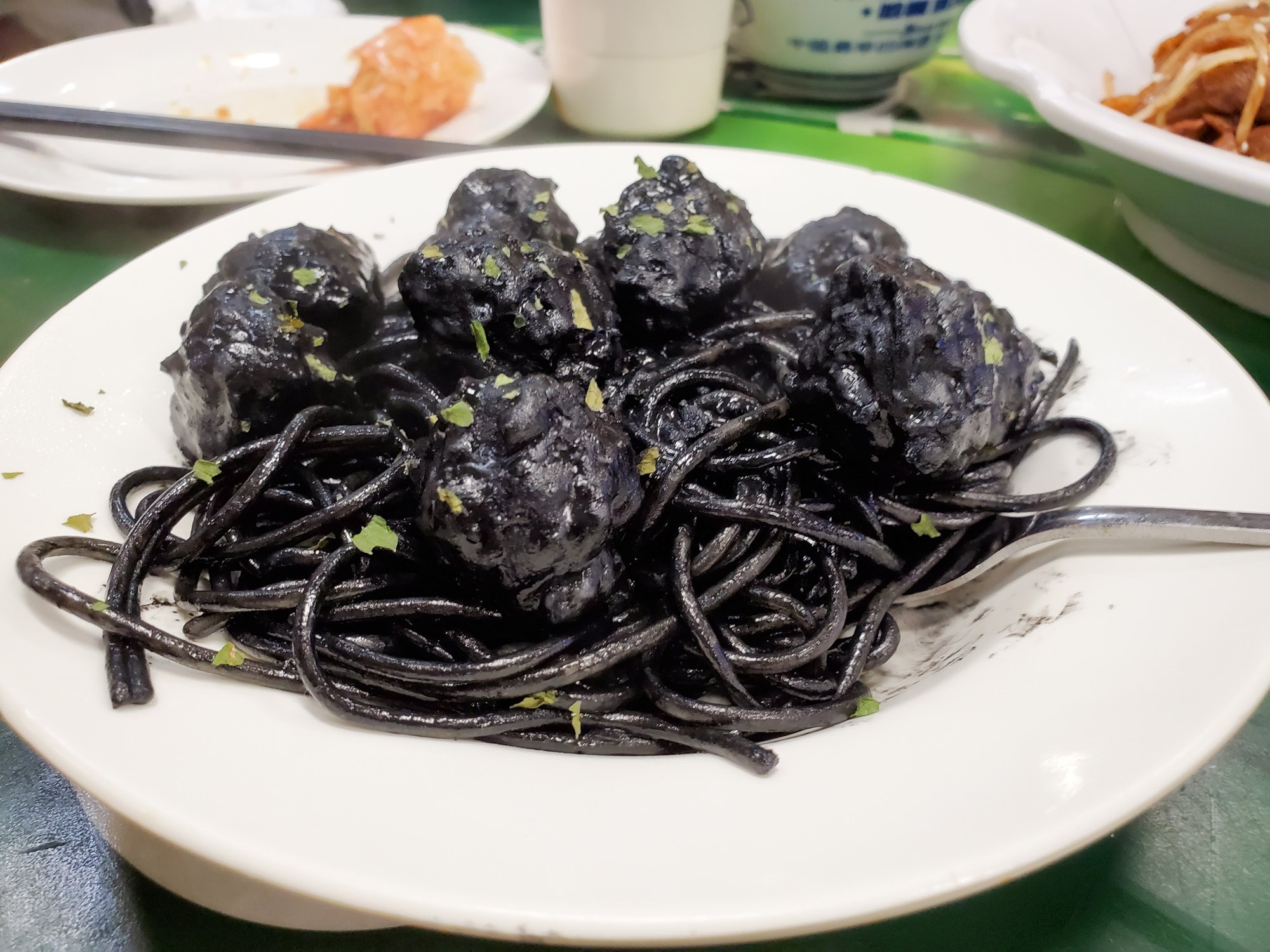 cuttlefish black squid ink spaghetti meatballs at tung po kitchen in hong kong
